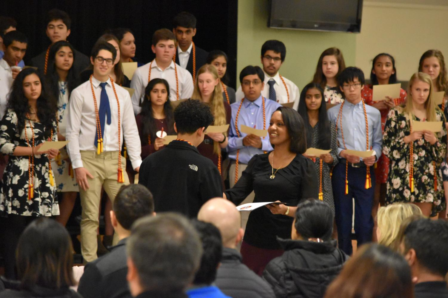 Sra.+MilyBett+Llanos-Gremillion+shakes+hands+with+inductees+and+hands+them+their+certificates.