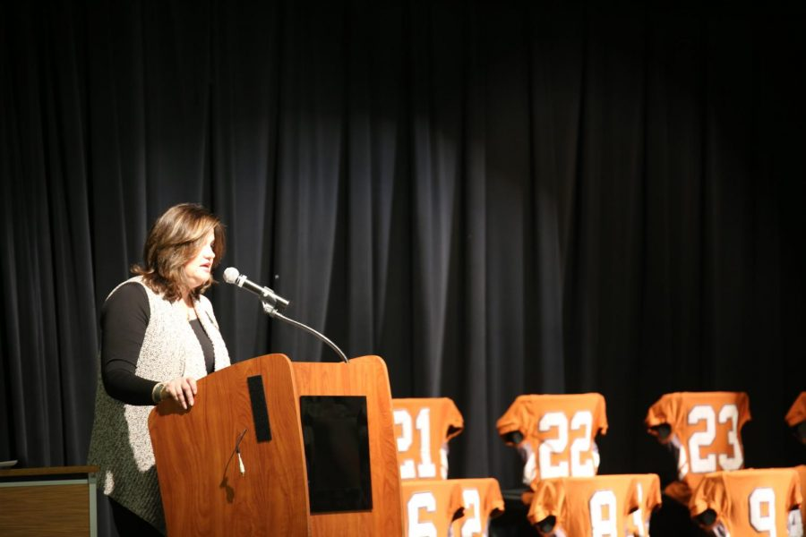 President [INSERT NAME HERE] of the football Booster Club delivers her farewell address.