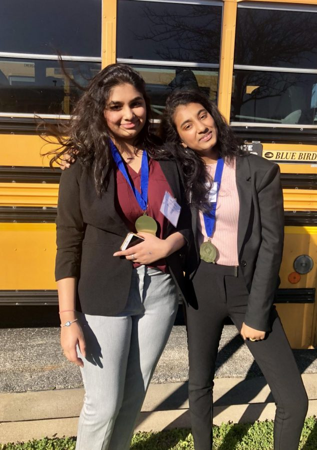 Students Akshita Vemula 21 and Sahaana Thangadurai 21 wear their medals after the prize ceremony.