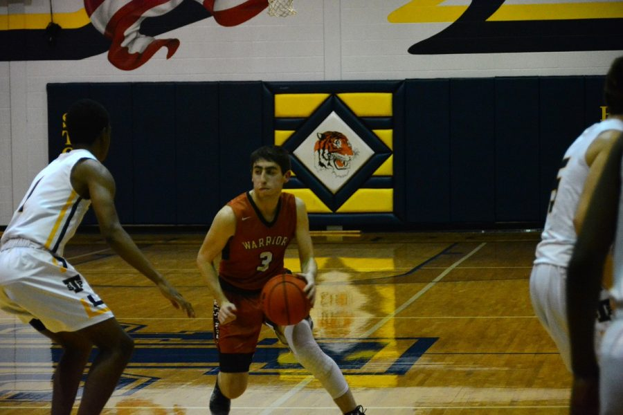 Corey Levinson 19 drives on a Stony Point player.