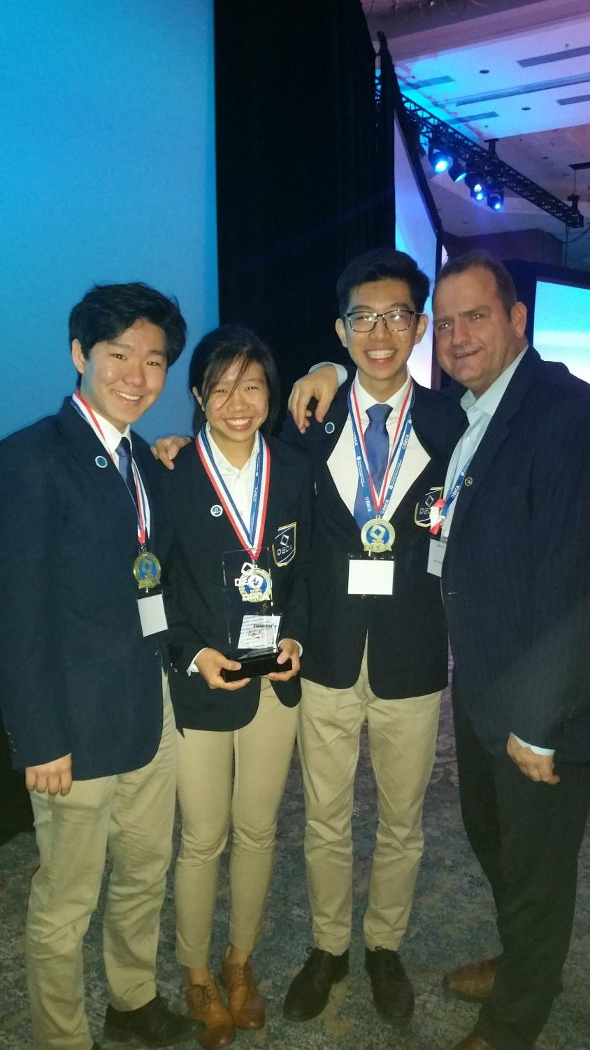 ICDC+qualifiers%2C+Ian+Chiu+%2719%2C+James+Joh+%2719%2C+and+Anna+Chiu+%2721+pose+with+sponsor%2C+Jeffery+Siler%2C+after+they+received+their+award.