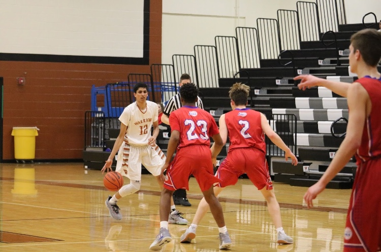Anish Maddipoti '20 dribbles the ball as he searches for a way to get past the Leander Lions.