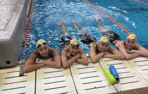 The girls' 200-yard medley relay team relaxes in the UT warm-up pool. Photo Courtesy of Matt McBrearty
