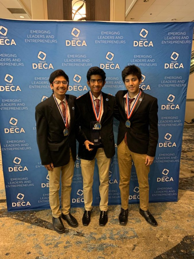Sophomore DECA students Sahil Shah, Joshua Robert, and Swapnil Dash hold their trophy after getting qualified to ICDC.