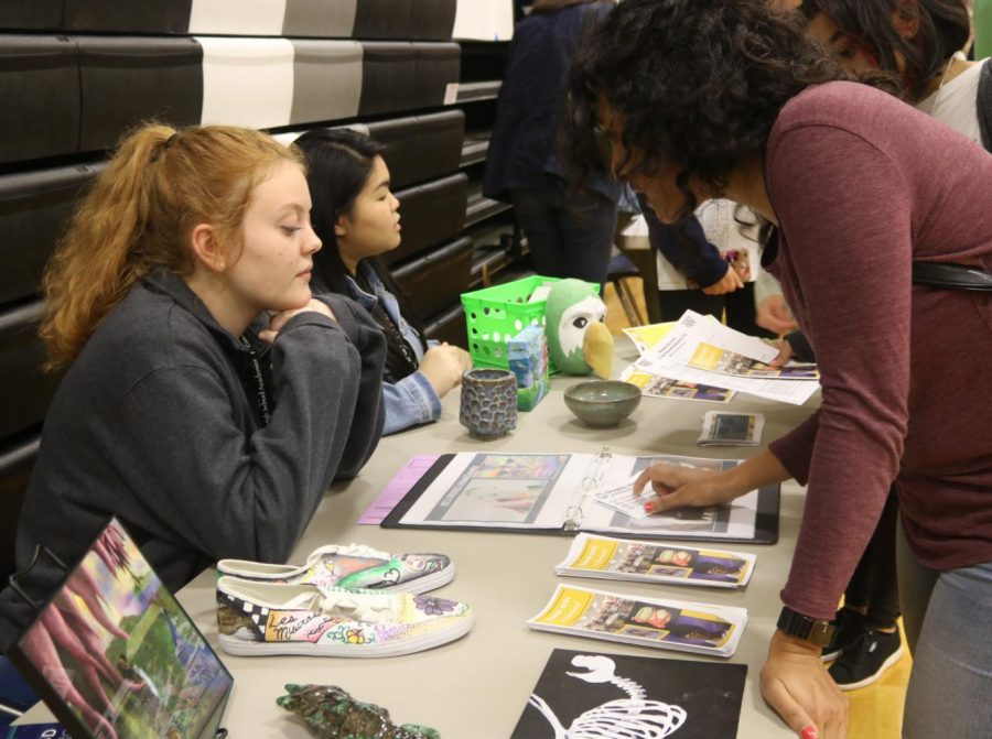Art students help answer questions of eighth grade parents and students.