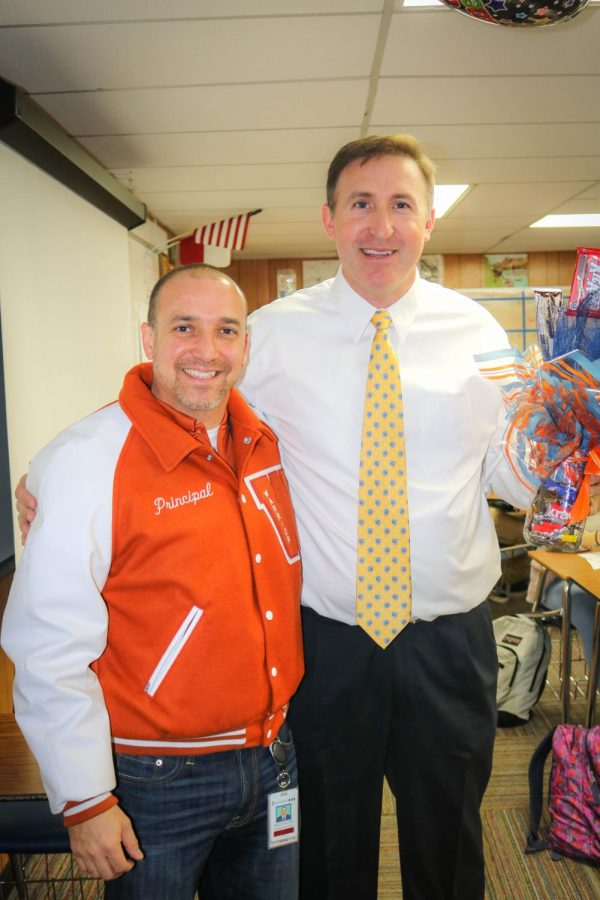 Mr. Acosta stands with Mr. Ziebell for a photo.