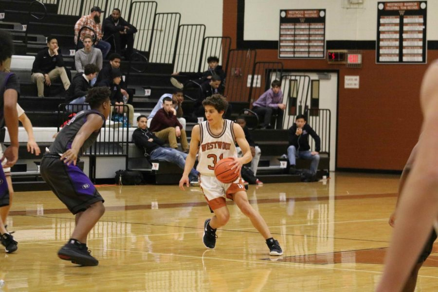 Luca Cipleu '21 brings the ball to the Warriors' side of the court.