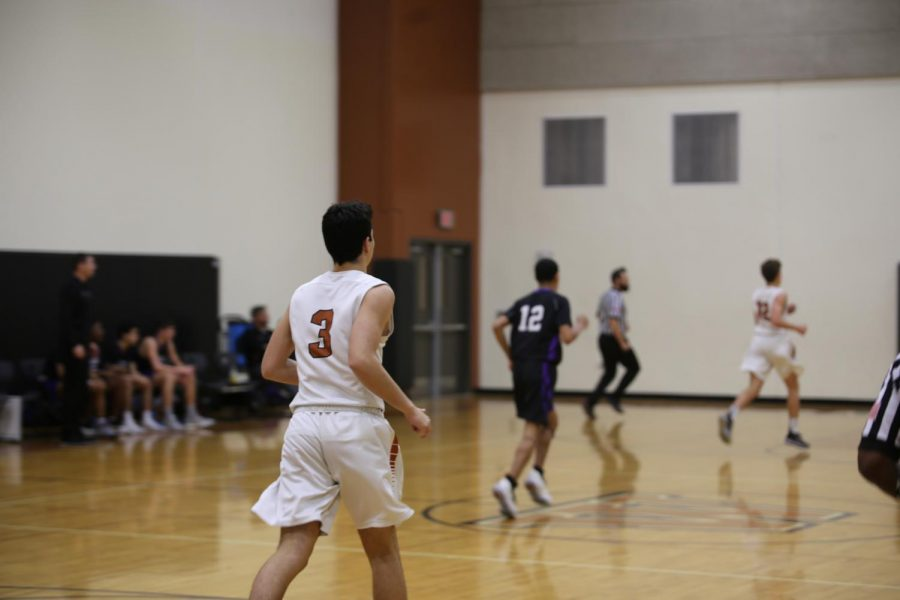 Eric Cadar '22 hustles to the hoop for a free throw.