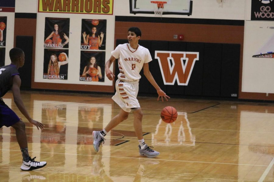 Anish Maddipoti '20 surveys the court for a teammate to pass to.
