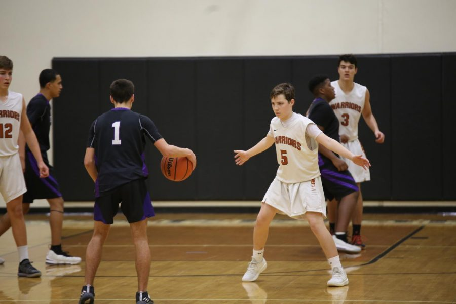 Karsten Bresser '22 takes a defensive position to prevent an enemy score.