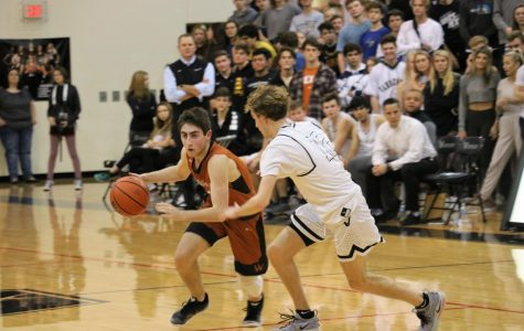 Varsity Boys' Basketball Suffers Defeat Against Vandegrift 65-50