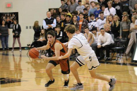 Varsity Boys' Basketball Suffers Defeat Against Vandegrift 65-50