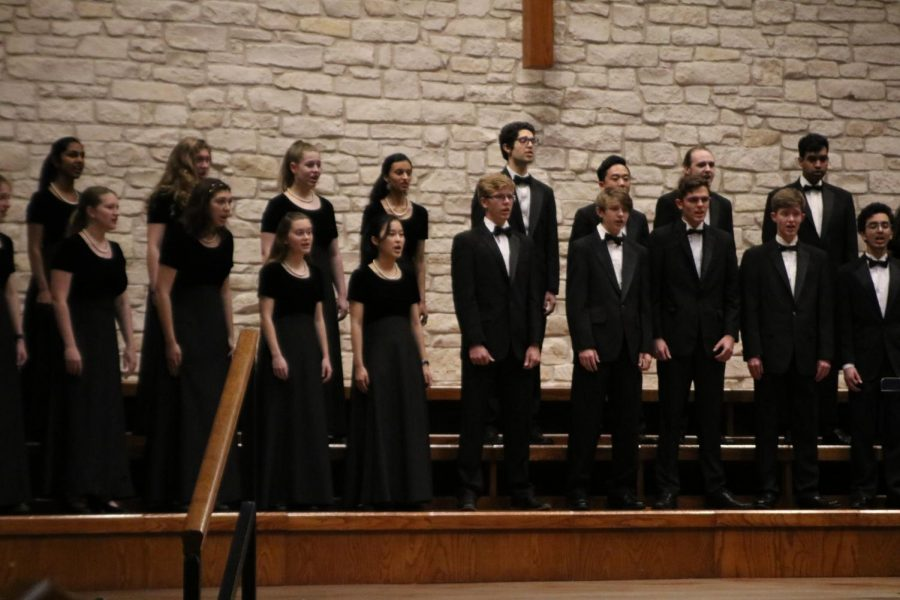 Chamber choir warms up before the concert.