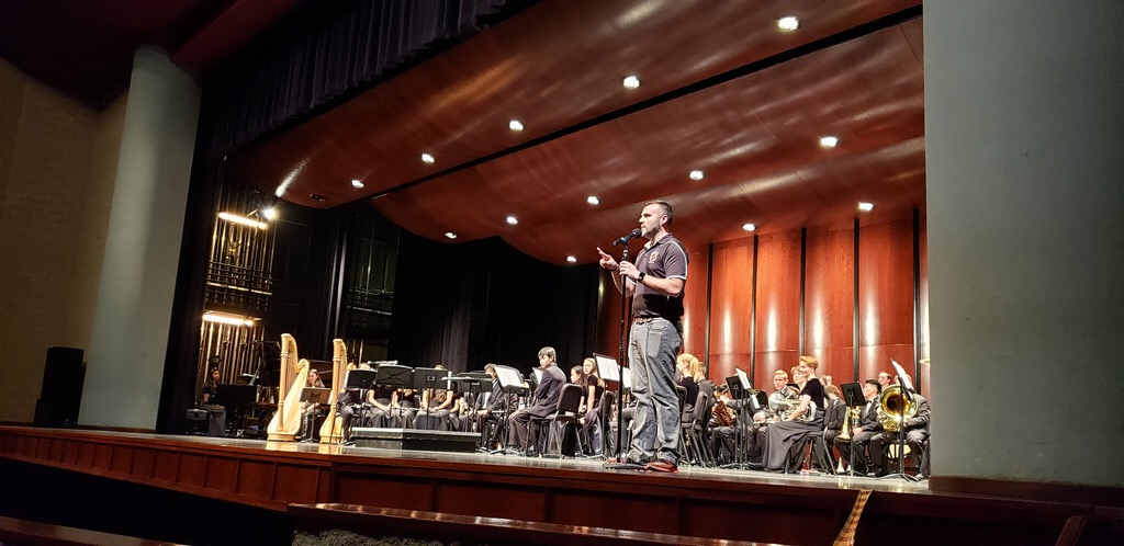 Mr.+Thomas+Turpin+speaks+at+the+concert+before+the+Wind+Ensemble+begins+their+performance.
