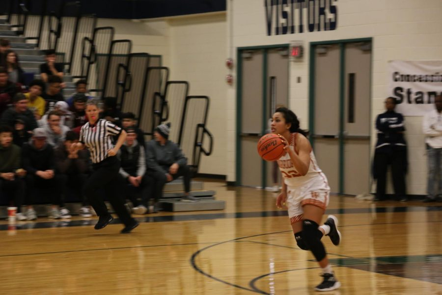 Makayla Coy '19 recovers a rebound and rushes to the other side of the court.