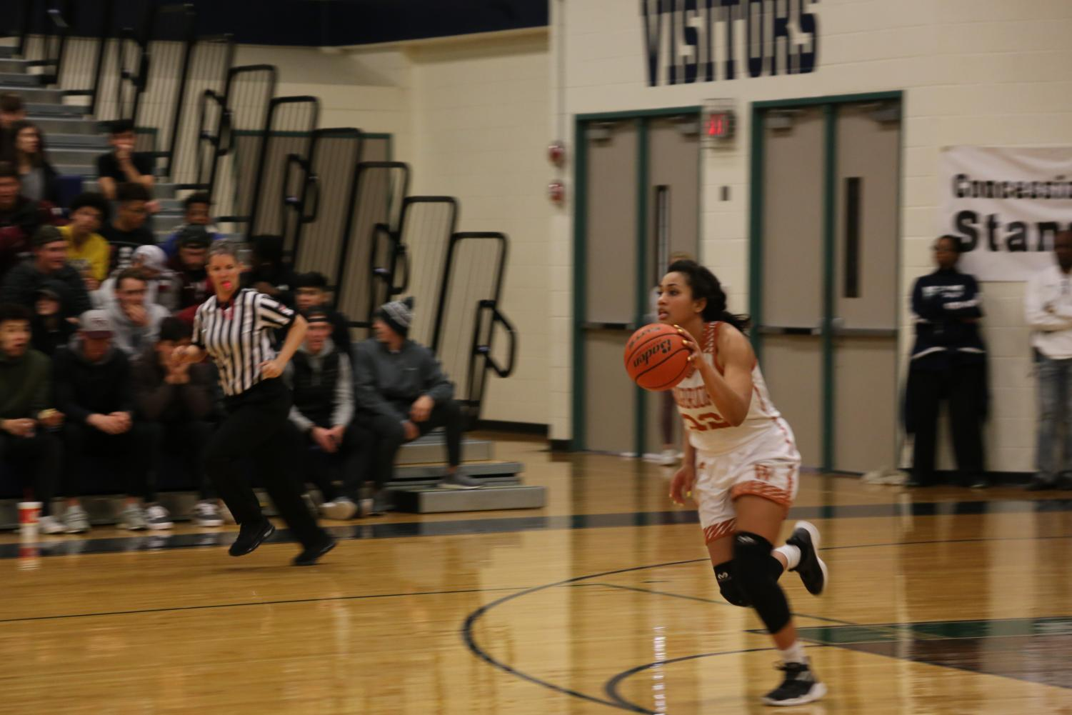 Makayla+Coy+%2719+recovers+a+rebound+and+rushes+to+the+other+side+of+the+court.