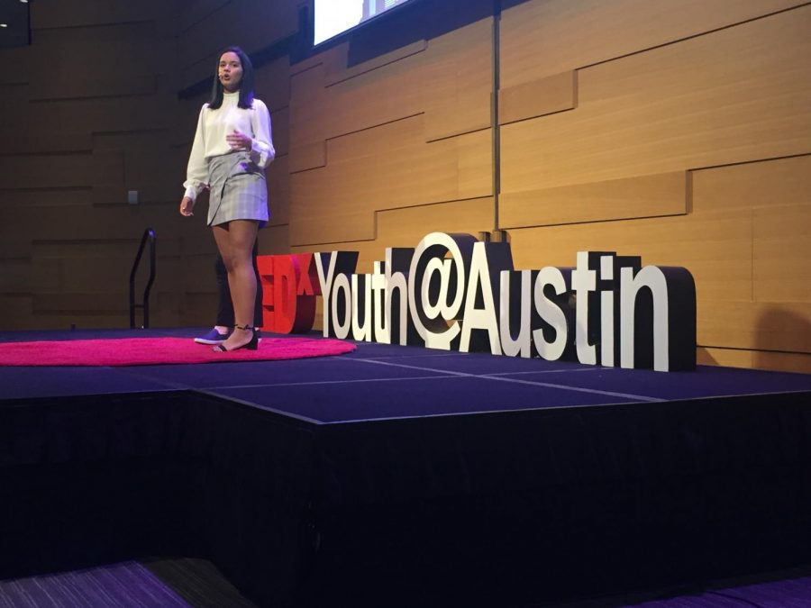 Aarushi Machavarapu 19, logistics director for TEDxYouths Austin Chapter, introduces the following speaker.