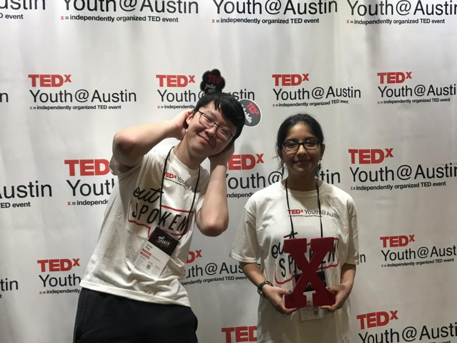 Juniors Carson Wang and Vani Shah pose at the TEDxYouth photo booth.