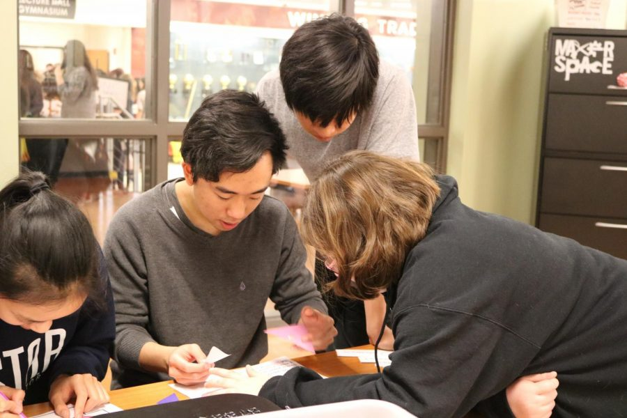 Anthony Pham '19 frantically works a piece of a puzzle while Ethan Lao '19 and Ashylnn Arcaya '20 help out.