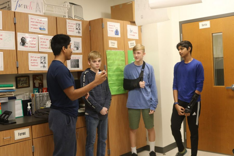 John Abreu '21 and his group act out a commercial for their French project that promotes hygiene.