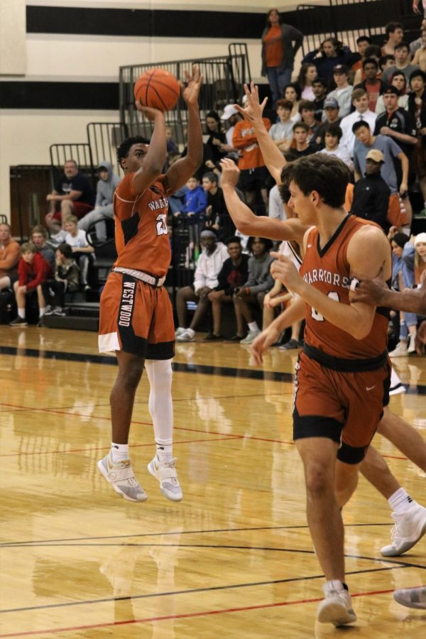 Brandon Parks 20 takes a three as Ethan Brown 19 looks on.