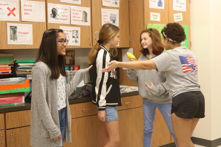 French students perform a skit that represents a commercial for lipstick.