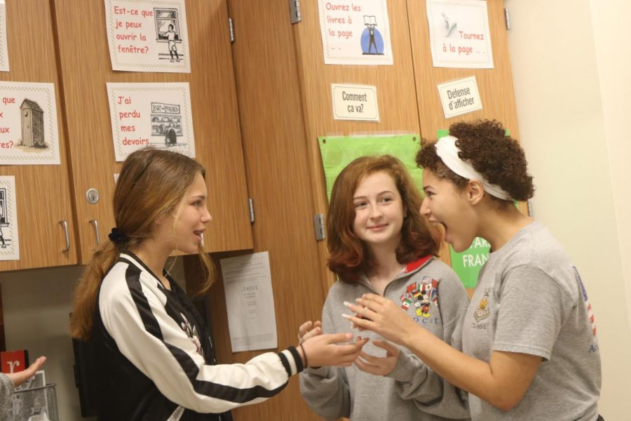 Miranda Ward '22 and her classmates act out an argument for a mock lipstick commercial in their French class.