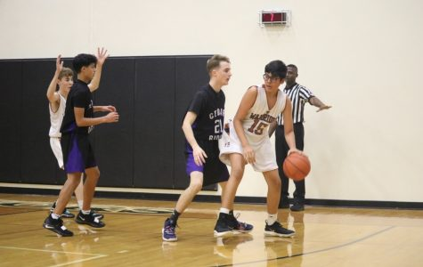 GALLERY: Freshman White Boys' Basketball Overtakes the Raiders