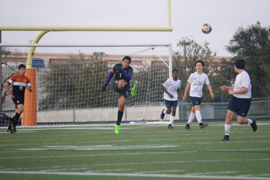 Shoumik Roychowdhury '22 kicks the ball across the field.