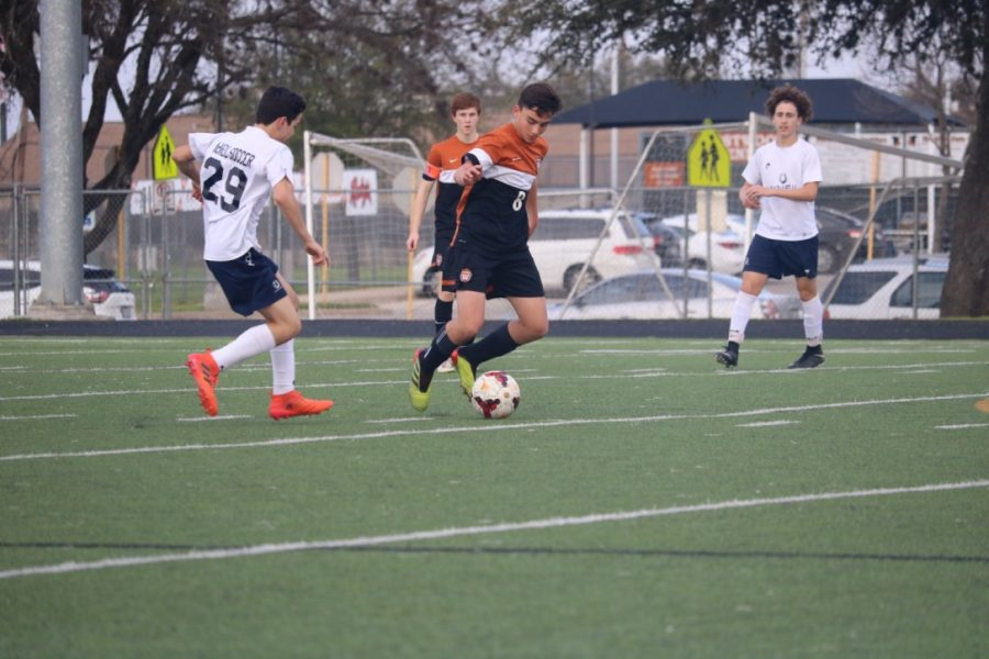 Andrew Bailey '22 gets to the ball and dribbles it across the field.