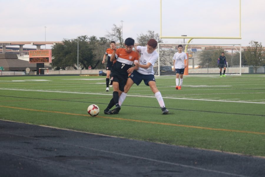 Emanuel Molina '21 tries to get the ball from a McNeil player.