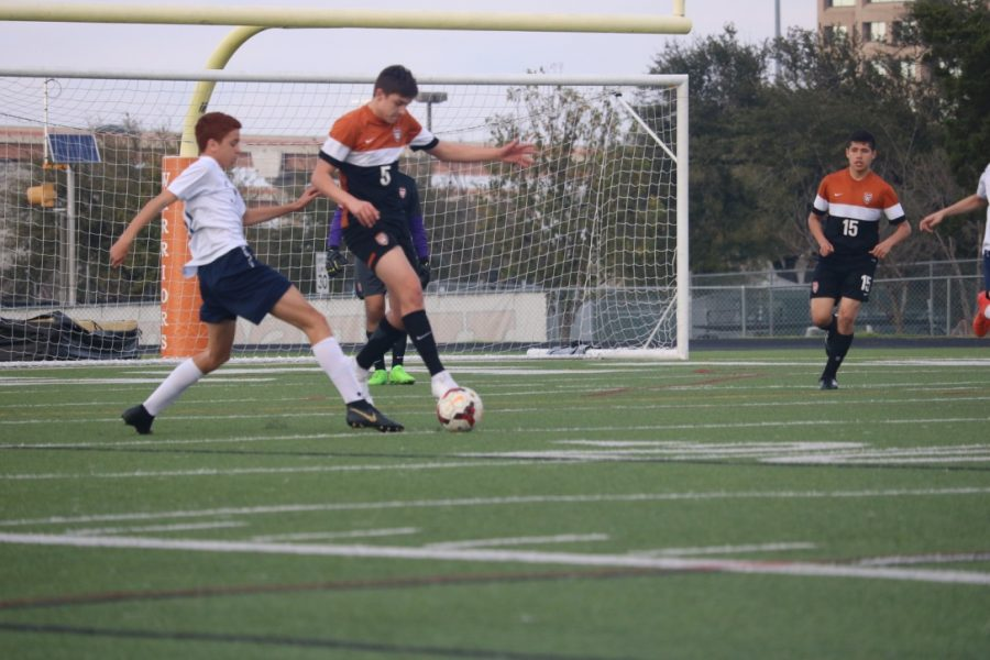 Alexander Swanson '22 jumps to the ball.