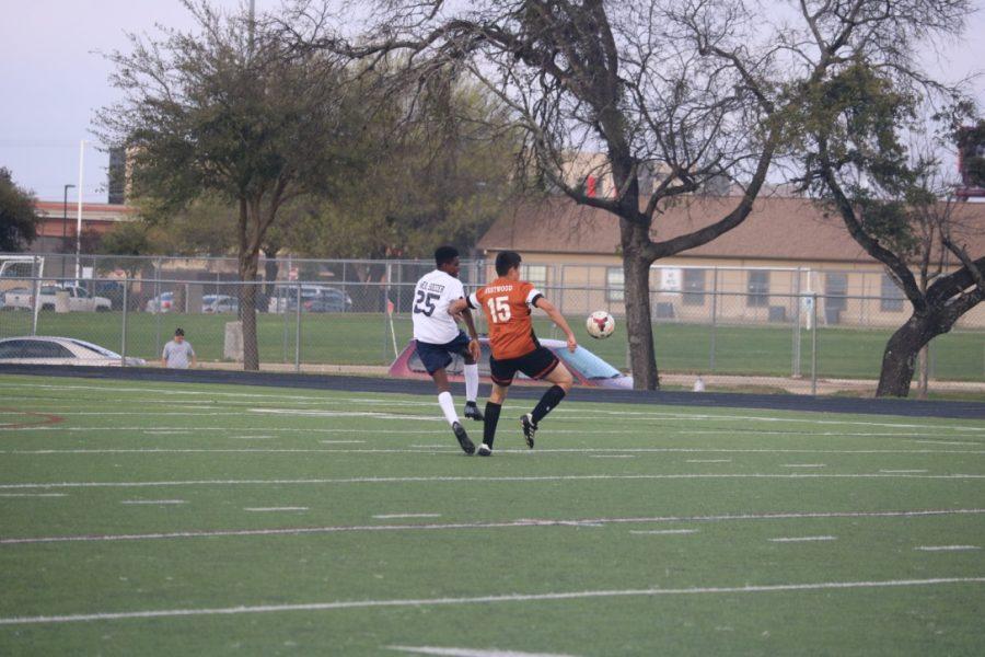 Jose Brito Sanchez '21 sprints to get the ball.