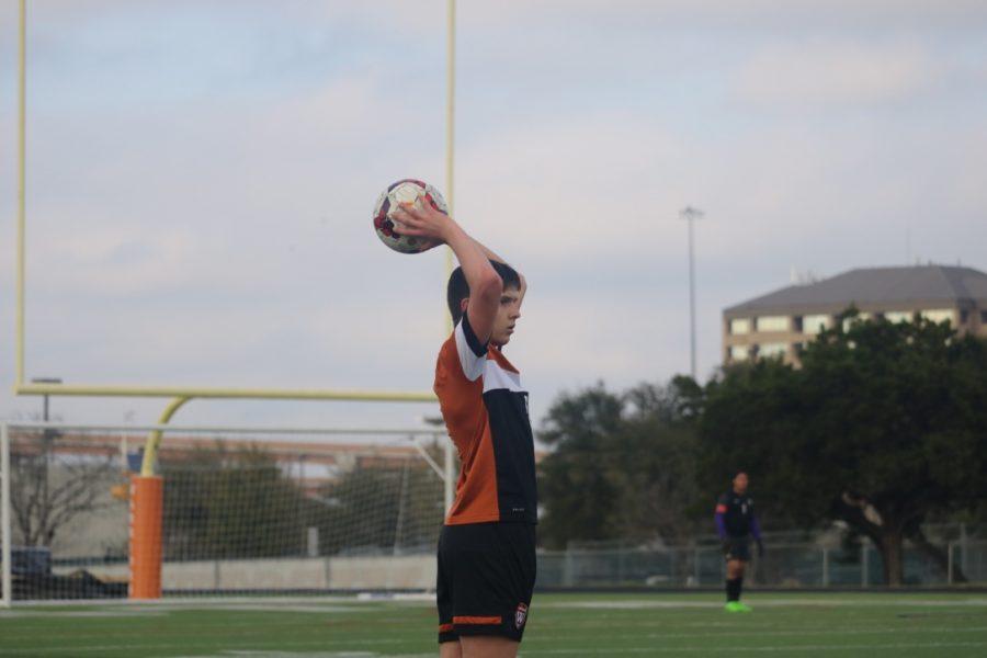 Alexander Swanson '22 throws the ball towards teammates.