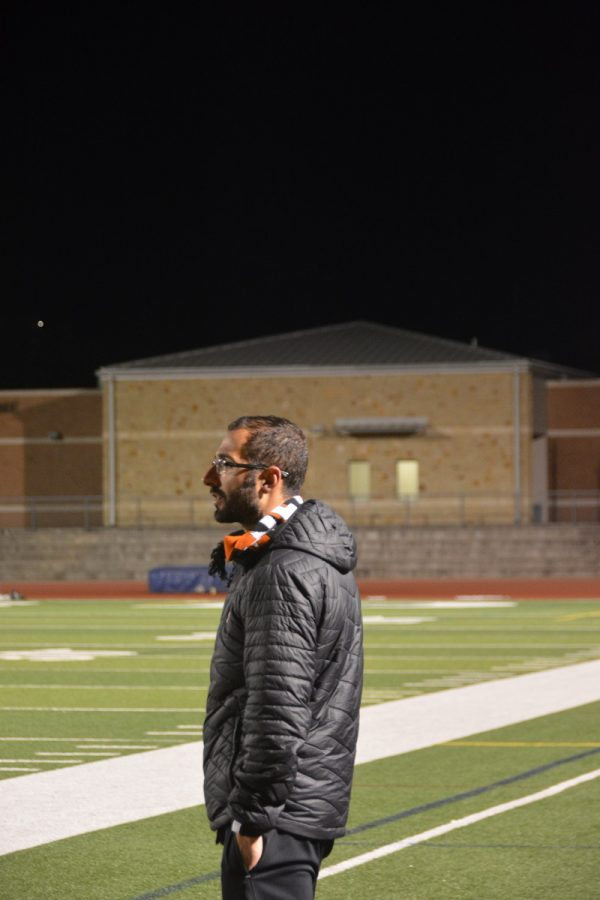 Coach Stefano Salerno watches the team on the pitch.