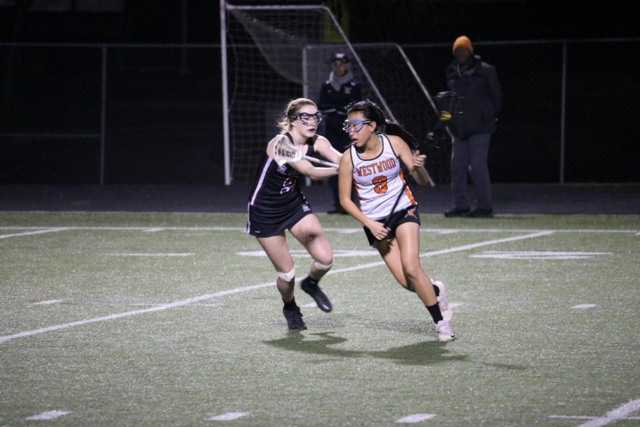 Joy Yang '22 fights against the opponent in an attempt to score a goal.