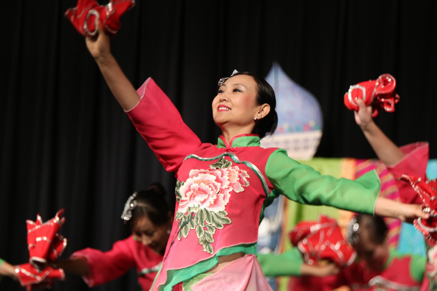 In+a+synchronized+dance+performance%2C+the+performer+uses+her+props+during+a+classical+Chinese+dance.