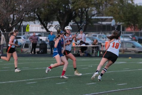 Varsity Girls' Lacrosse Defeathers Eagles 11-7