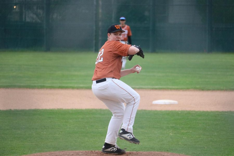 Reid Saxon '22 winds up to pitch the ball.