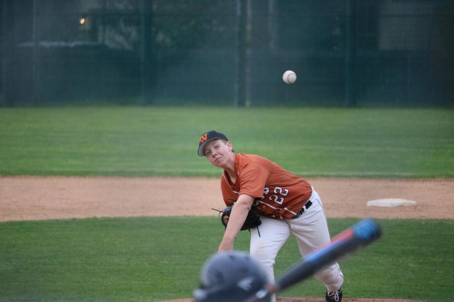 Reid Saxon '22 pitches the ball for an opponent.