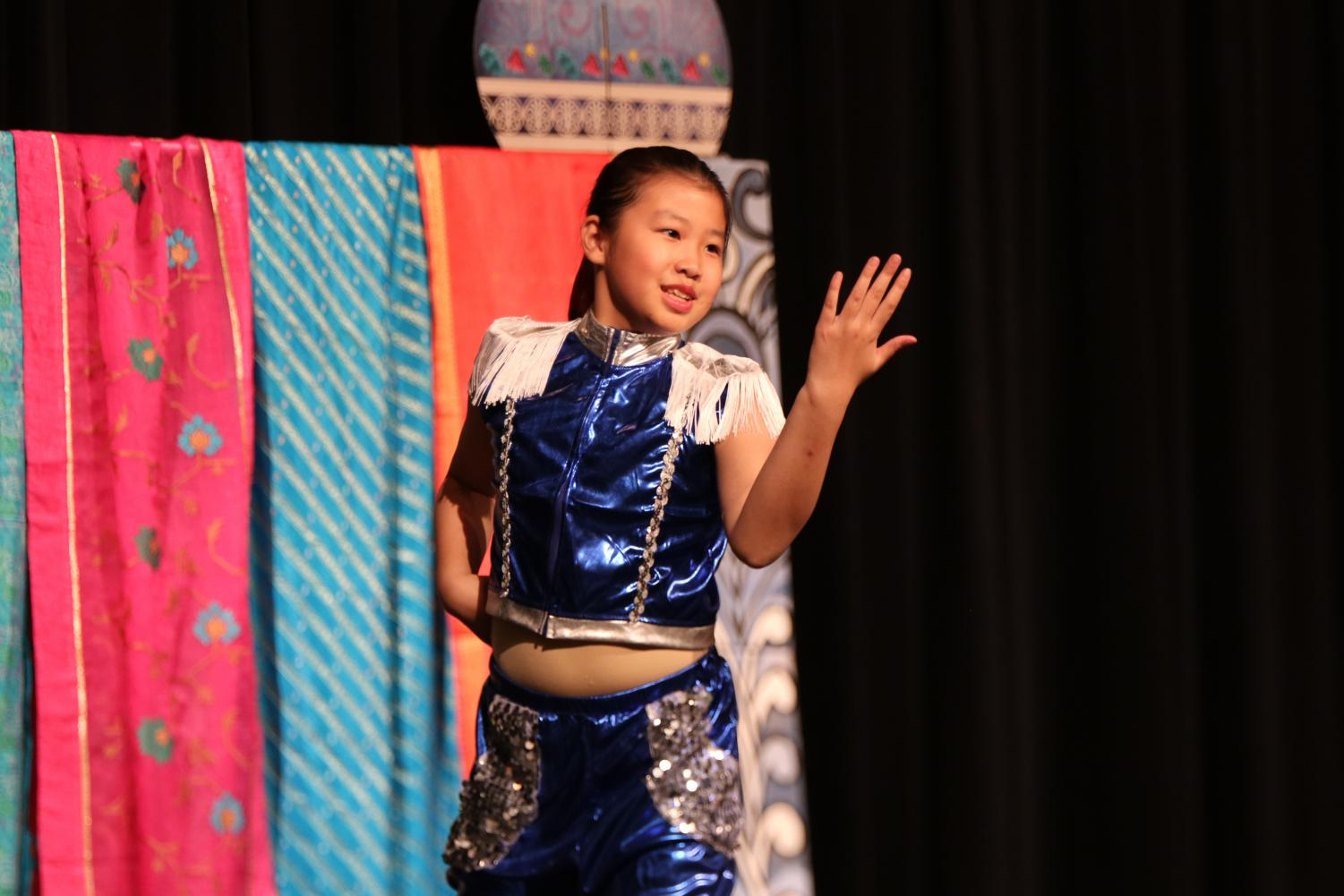 A+performer+from+Laurel+Mountain+Elementary+School+dances+to+a+modern+Chinese+song.