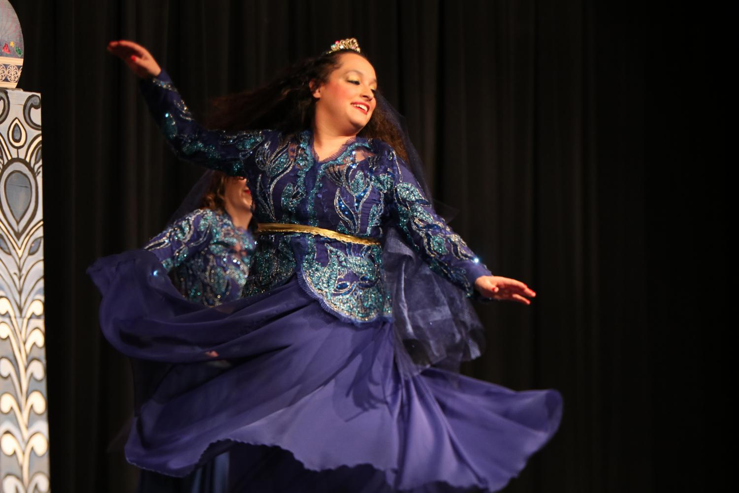 A+performer+from+UT+Austin+spins+in+her+Persian+dance.