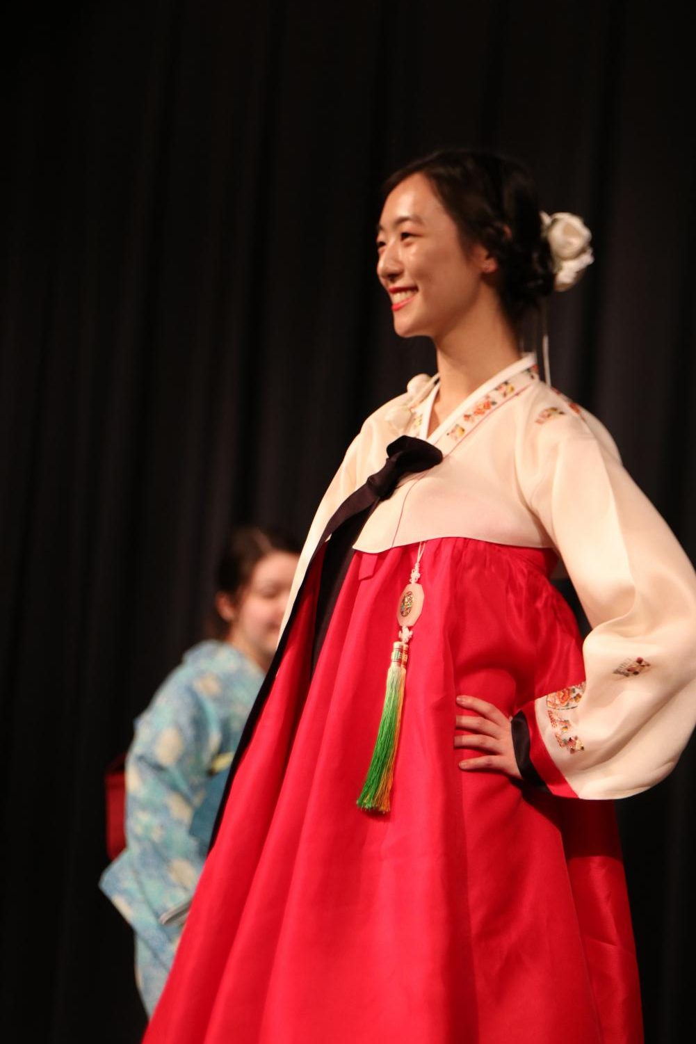 Janice+Oh+%2719+smiles+as+she+wears+traditional+Korean+attire+at+the+fashion+show.