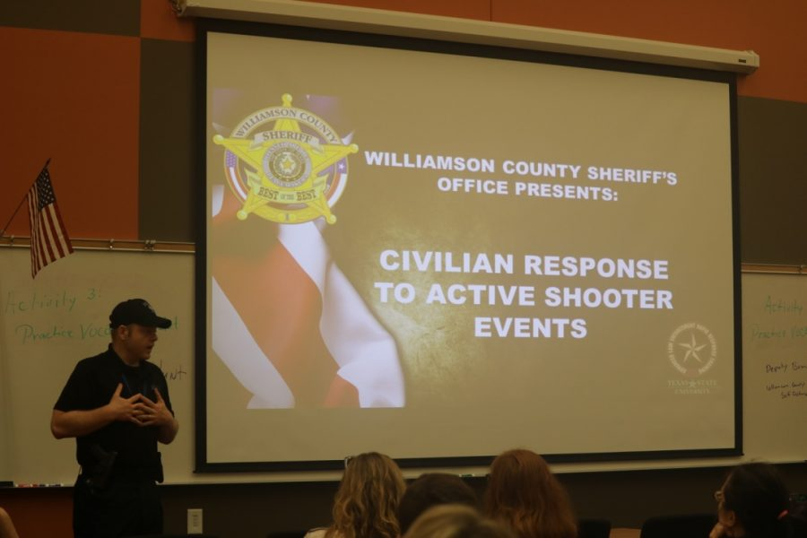 An officer introduces the topic of the meeting.