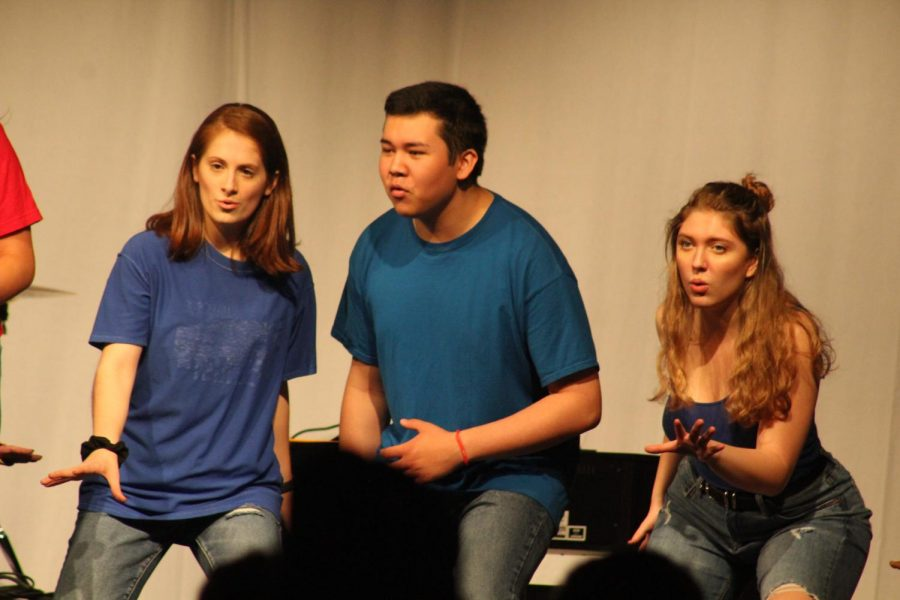 Juniors Rachel Rusch, Michael Celey, and Nicole Boisseau dance during one of Chamber Choirs songs, Some Nights by Fun.