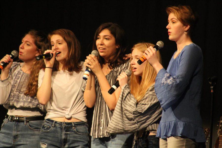 Juniors Nicole Boisseau, Rachel Rusch, Katya Lopez, Elsa Hughes, and Lanie McFadden sing Super Trouper by ABBA.