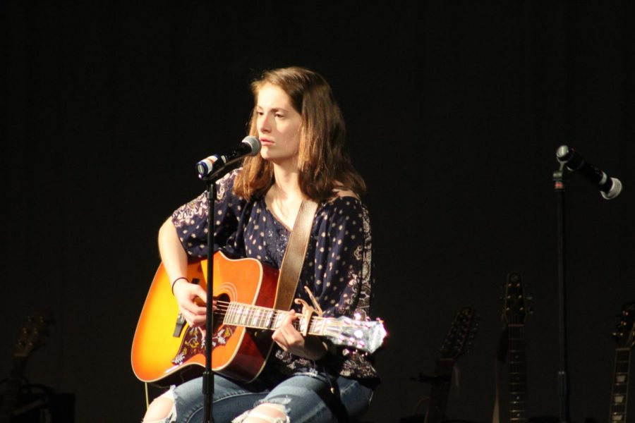 Rachel Rusch 20 plays the guitar during her solo Never Be Alone by Shawn Mendes.