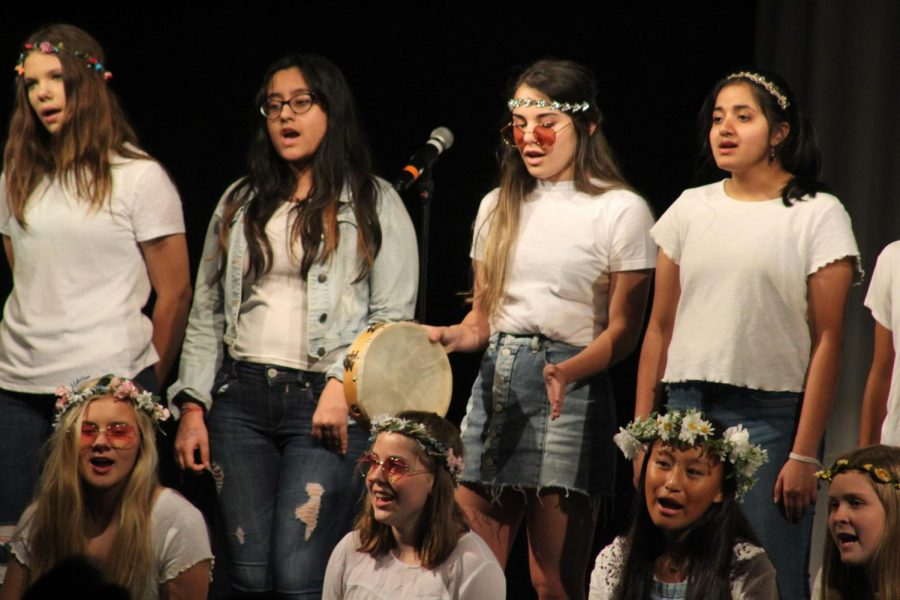 Concert Womens Choir dresses up in bohemian clothes to sing Closer to Fine by Indigo Girls.