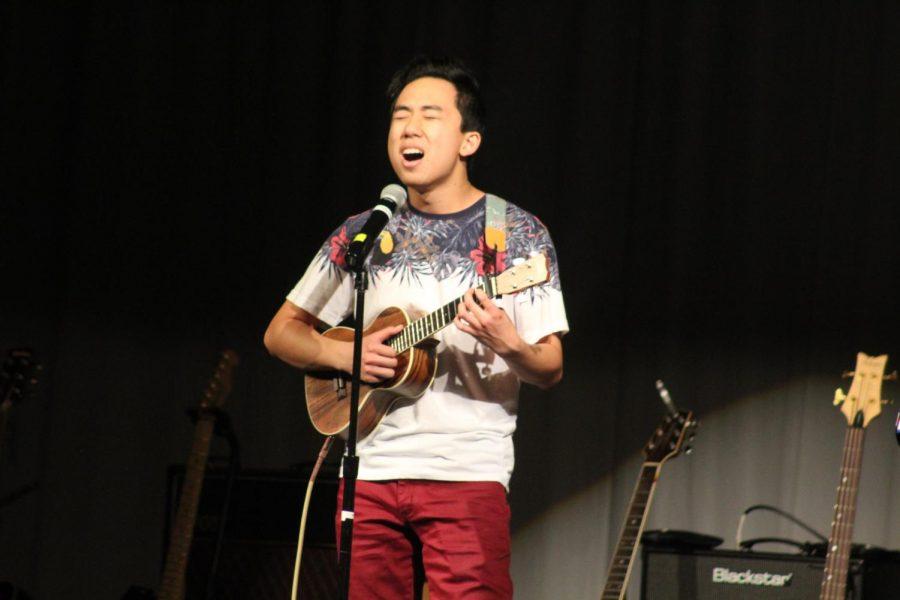 Anthony Pham 19 plays the ukulele while singing his solo, Sunday Morning by Maroon 5.