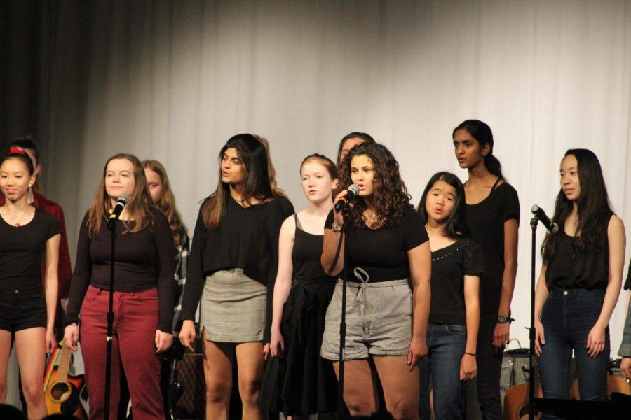 Amanda Skevofilax 21 sings her solo during the Varsity Womens song.